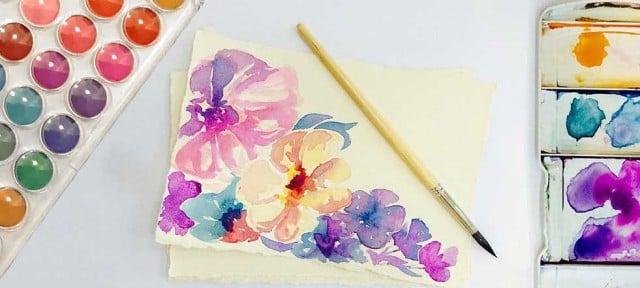 pinturas acuarelas y pincel